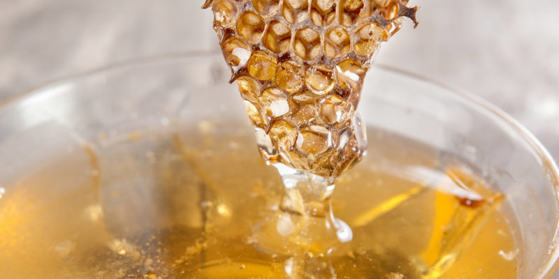 Glass honey pot and honey comb